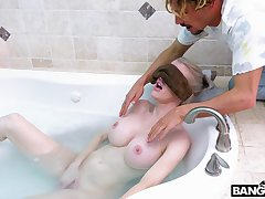 Mommy with huge silicone boobs Katie allows her stepson to join her in the bathtub
