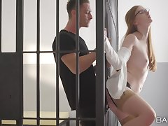 Redhead works enduring to make this inmate cum on her face