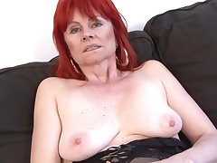 Red haired granny in erotic lingerie is having casual coition with a malignant guy, atop an obstacle sofa